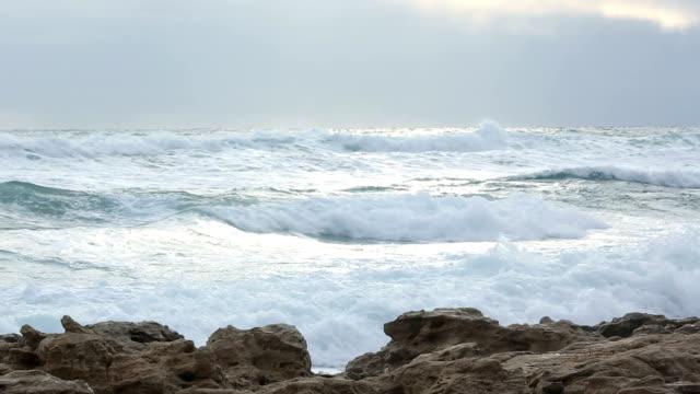 Waves crash along shoreline after storm
