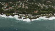 AERIAL, Waves crashing against shore at holiday resort, Jamaica