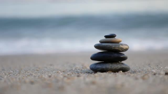 MS Waves crashing behind zen pile of stones/Singapore