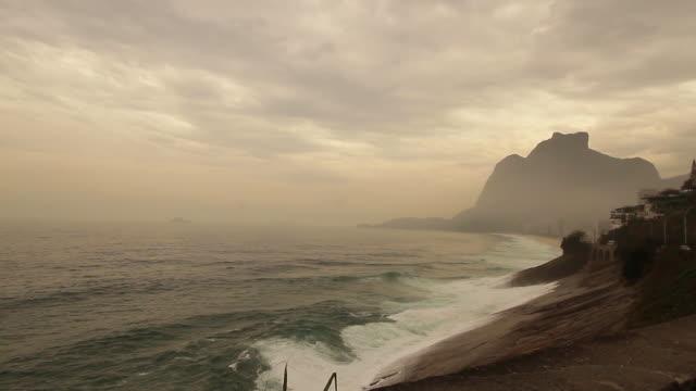 Waves hitting beach rock in Rio de Janeiro