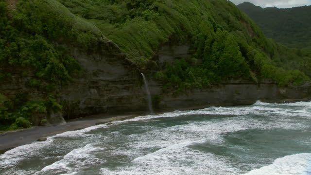 Waves in Rosalie Bay and the Wavine Cyrique waterfall of Dominica.