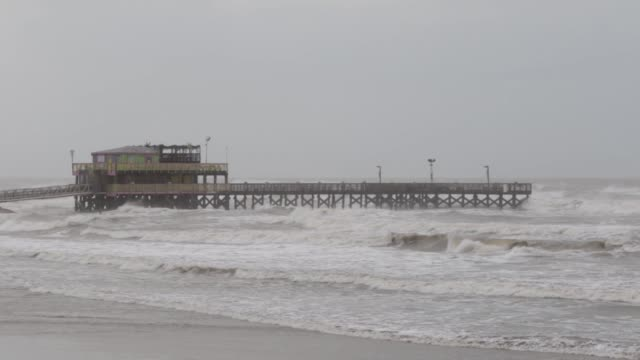 Waves pound a business on a pier in Galveston Texas US on Thursday Aug 25 2017 Hurricane Harvey set to make landfall on the center of the Texas coast...