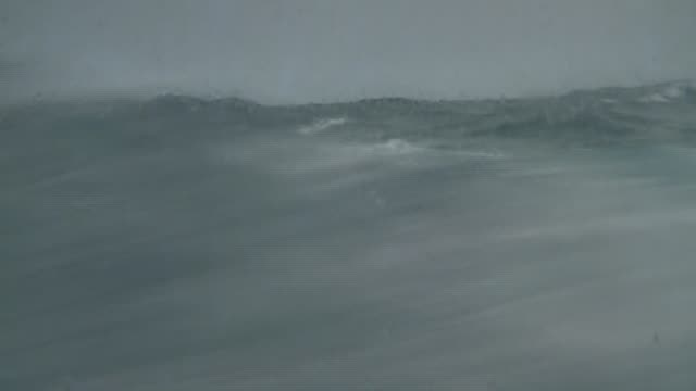 Waves rage in a stormy ocean. Available in HD.