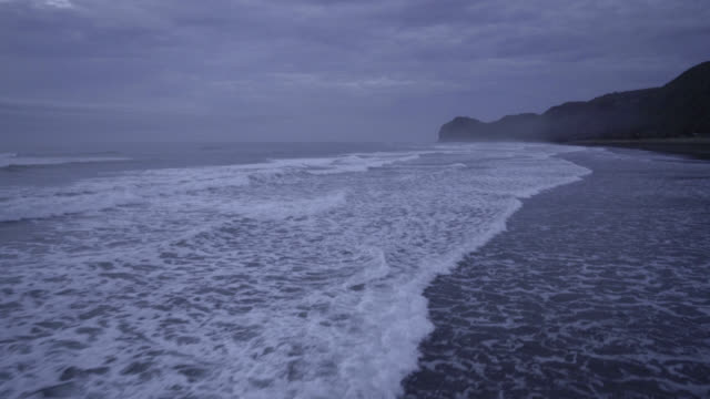 Waves roll into beach