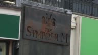 Wayne Rooney banned from driving for 2 years Cheshire Wilmslow EXT 'The Symposium' bar sign PULL OUT Reporter to camera
