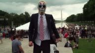 Wearing piercings and horror makeup a thousand fans of controversial US rap group Insane Clown Posse descend on Washington alleging discrimination...