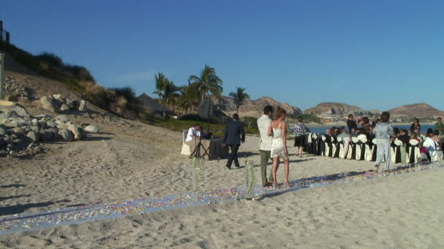 WS, PAN, Wedding guests gathering for ceremony on beach of Cabo San Lucas, Mexico
