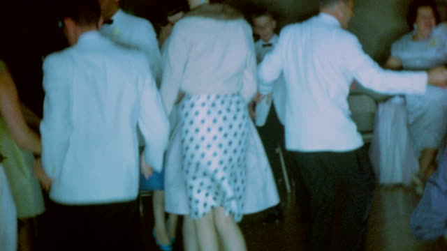 Wedding reception with people dancing the hora