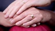 Wedding ring hands loving caress