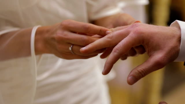 Wedding Ring is placed on Groom's finger during Vows ceremony