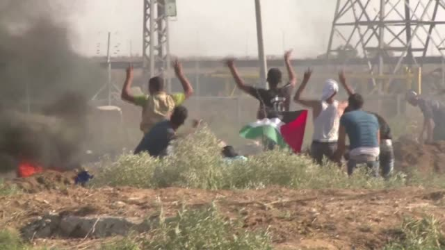A week of violence between Israelis and Palestinians spread to the Gaza Strip Friday with Israeli troops killing five people in clashes on the border...