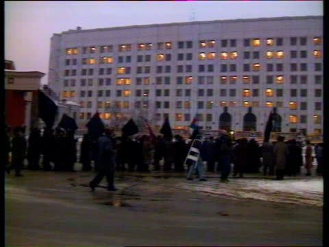 Weekend fighting aftermath INT Location Unknown CMS Andreas Raid intvw SOF Moscow GV Marchers outside Ministry of Defence building PAN LR more ditto...
