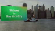 Welcome to New York City sign dragging after small boat