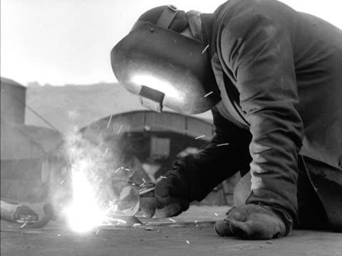A welder at work at the Port Glasgow shipyard