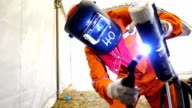 Welder at work of Gas tungsten arc welding (GTAW) in metal industry