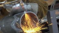CU Welder cutting metal pipe in design with welding torch / Chico, California, USA