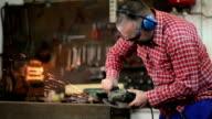 Welder Grinding Metal Plate At Work