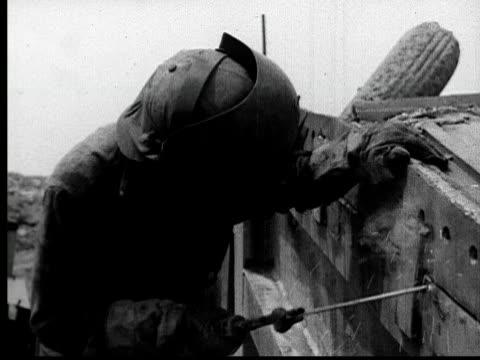 1935 MS welder in protective mask welding