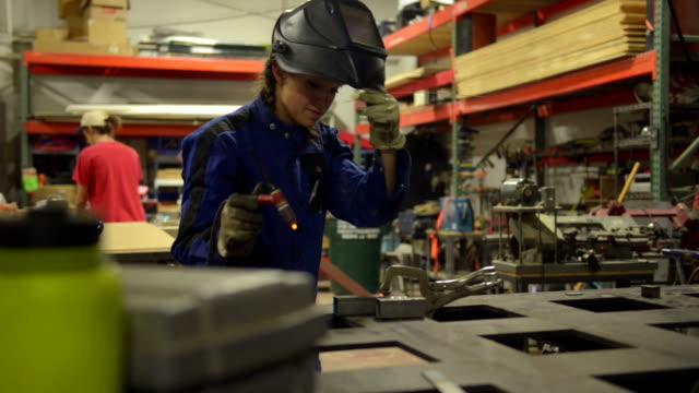 Welder worker girl - DOLLY SHOT