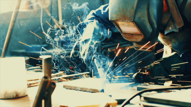 Welding two steel tubes in slo mo.