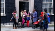 Downing Street petition / Yvette Cooper interview ENGLAND London Downing Street EXT Various of Yvette Cooper MP delivering 'Help Mums Not...