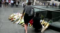 Well wishers in Sydney leave flowers at the scene of a dramatic siege which left two hostages dead