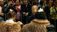 Wellington EXT Maori men performing haka war dance at welcoming ceremony for Prince William Woman presenting William with photograph Prince William...