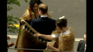 Wellington EXT Prince William receiving official Maori welcome being wrapped in Kiwi feather cloak and participating in hongi greeting with officials