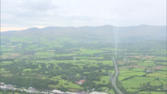 Welsh air ambulance general views INT Various views of Welsh countryside from Air Ambulance helicopter as in flight and crew flying helicopter /...