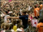 Mass screaming fans George Michael lookalike in crowd fan taken away after fainting from the heat bottles of water given out interviews with fans...