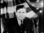 Wendell Willkie speech continued / speaks to cameras at desk in front of large draped American flag / Willkie warns against a partisan government...
