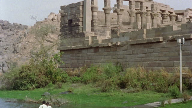 WS West colonnade at Temple of Philae/ TD WS boys in rowboat on the Nile/ TU temple/ Egypt