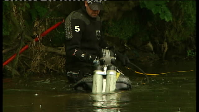 West Yorkshire Bradford EXT Suitcase being hauled out of River Aire by police divers