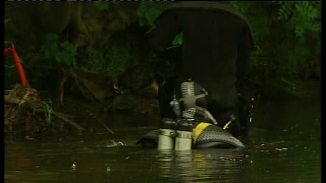 West Yorkshire Shipley EXT Police divers searching River Aire holdall / suitcase carried to riverbank