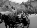 ROME ITALY Westbrook Van Voorhis riding by in open horsedrawn carriage TU WS Column ruins on hill above street