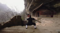 Western Kung Fu Disciple training in ancient ruins in the wudang shan mountains.