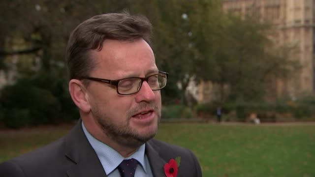 Theresa May promises new independent process to handle complaints Westminster EXT Rob Wilson interview SOT Union Jack flag flying with palace of...