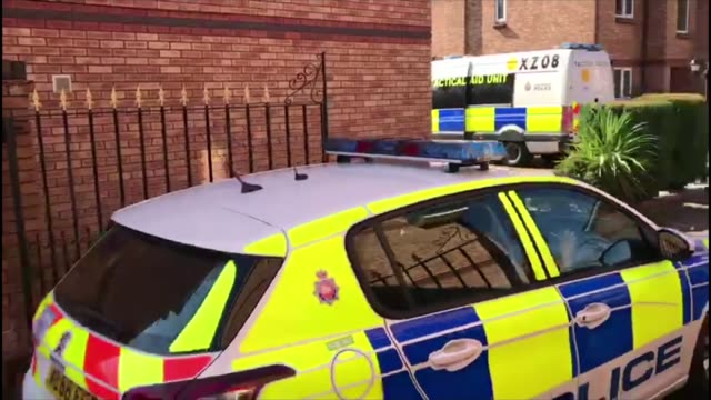 Khalid Masood background / police investigation Manchester Didsbury Police car through gates of housing development where a couple were arrested in...
