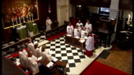 Westminster Council to start changing for Sunday parking in the West End **Music heard SOT** High angle view of congregation in church PAN to choir...