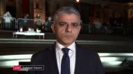tributes paid to victims ENGLAND London GIR INT Sadiq Khan 2 WAY interview from vigil in Trafalgar Square SOT/ CUTAWAYS crowds gathered for Trafalgar...