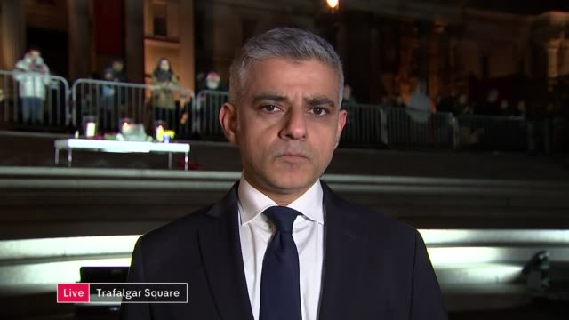 tributes paid to victims ENGLAND London GIR INT Sadiq Khan 2 WAY interview from vigil in Trafalgar Square SOT/ CUTAWAYS crowds gathered for Trafalgar...