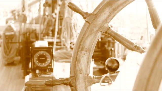 wheel of an old sailing ship and compass