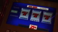CU Wheels of slot machine spinning in Las Vegas Casino / Las Vegas, Nevada, USA