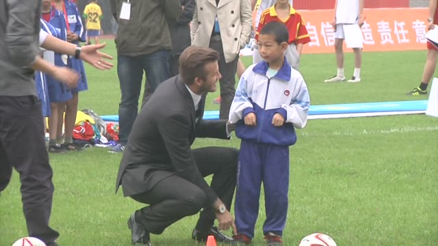 where he meets the Youth Football Team at Hankou Literary and Sports Centre David Beckham Visits Wuhan on March 23 2013 in Wuhan China