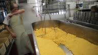 Whey is removed from a vat of Colby cheese at the Widmer's Cheese Cellars on June 27 2016 in Theresa Wisconsin Record dairy production in the United...