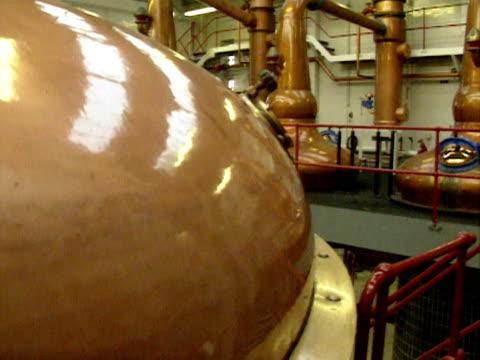 Whiskey stills in a distillery Scotland 1990s