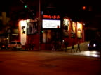 Whisky a Go Go exterior traffic passes in foreground Sunset Strip