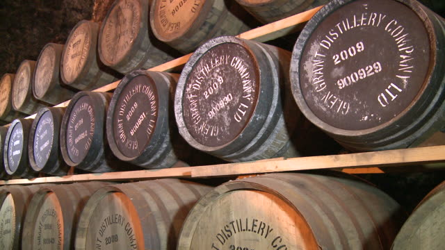 MS Whisky casks in warehouse / Rothes, Speyside, Scotland