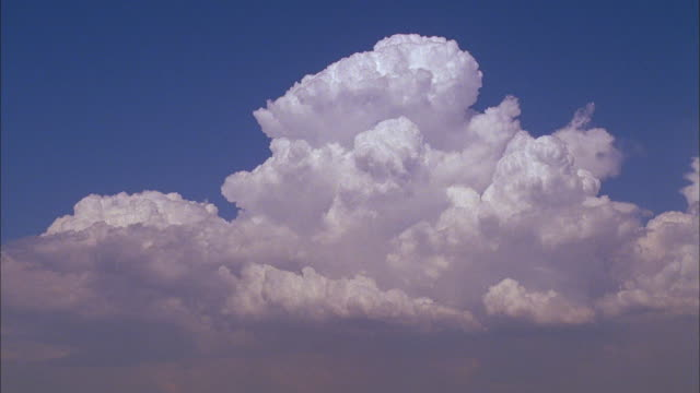White clouds billowing in blue sky Available in HD.