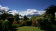 White clouds pass over a beautiful yard near Lake Tarawera and Mount Tarawera in Rotorua, New Zealand.